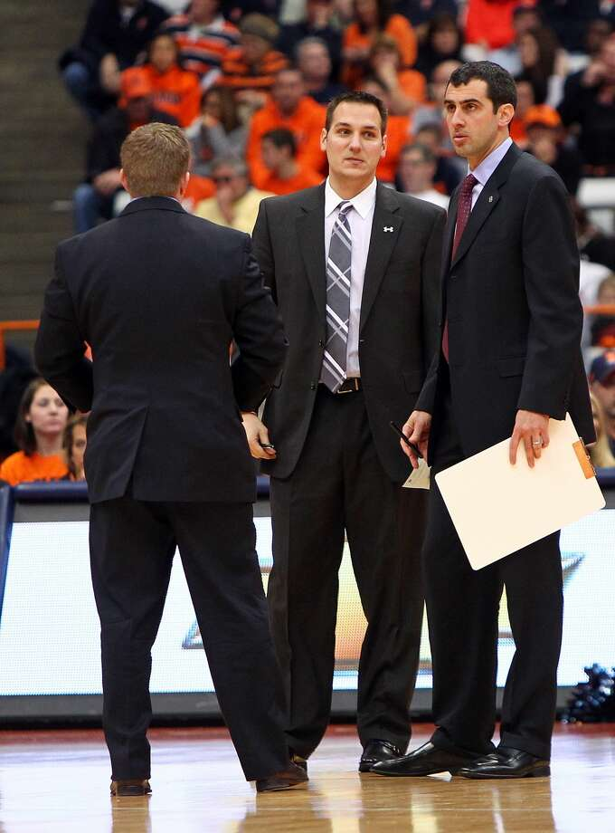 SYRACUSE, NY - NOVEMBER 25: Director of basketball operations Mark Linebaugh (center) talks with head coach Matt Langel (right) as they stand on the court during a break in play during the game against the Syracuse Orange at the Carrier Dome on November 25, 2012 in Syracuse, New York. (Photo by Nate Shron/Getty Images) Photo: Nate Shron/Getty Images