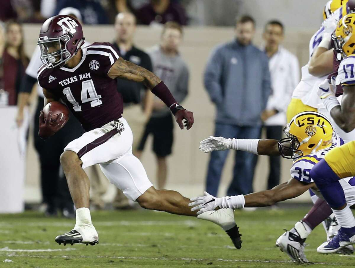 Texas A&M defensive back Justin Evans breaks away from LSU's Russell Gage on a kick return during the first quarter at Kyle Field on Nov. 24, 2016, in College Station.