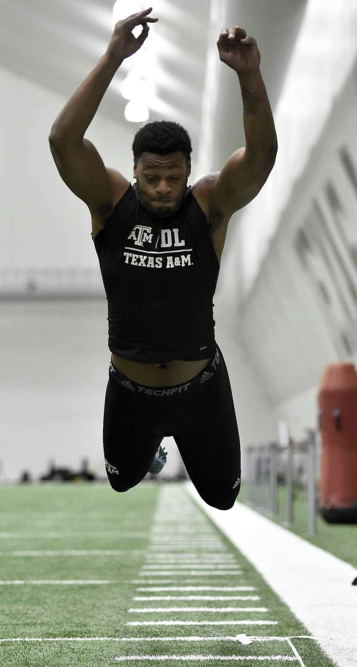Former Texas A&M defensive end Daeshon Hall performs a standing long jump during the Aggies' Pro Day at the team's indoor training facility on March 30, 2017, in College Station.