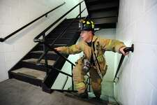 Stamford fire fighter Al Hagander runs up and down flights of stairs inside the Stamford Fire Station on E. Main St. in downtown Stamford, Conn. on Thursday, March 30, 2017. Hagander is training for the American Lung Association's annual New York City 'Fight for Air' Charity Stair Climb which requires fire fighters to climb 55 flights of stairs in full 50-pound gear.
