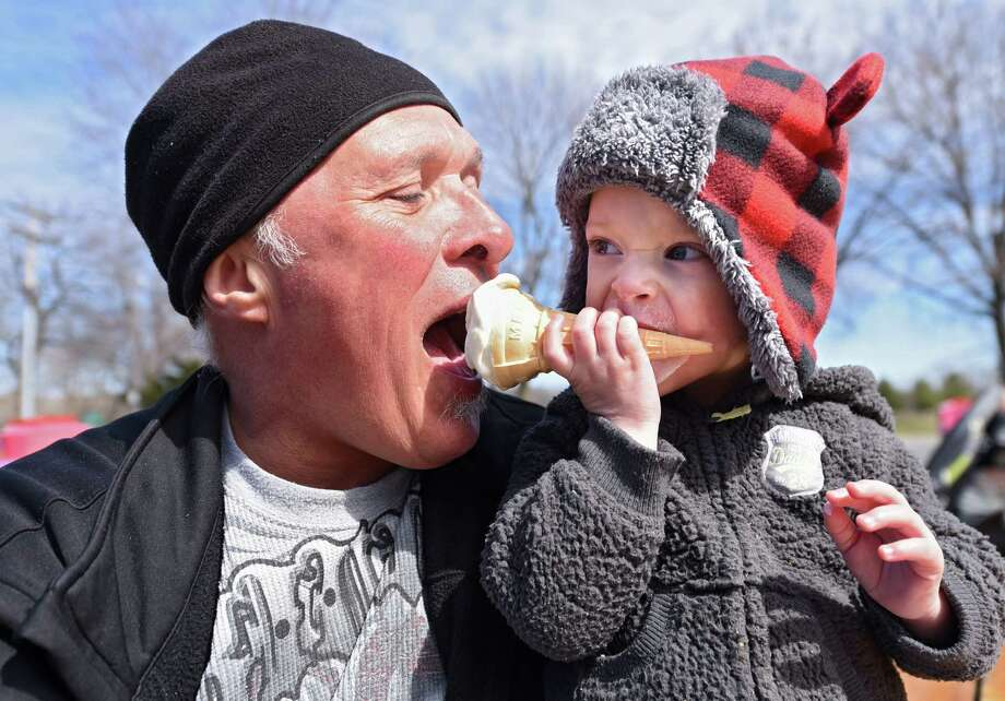Fred Berg of Scotia enjoys an ice cream cone with his grandson Jaxson Prudhomme, 1, at Jumpin' Jack's drive-in on the season's opening day Thursday, March 30, 2017 in Scotia, N.Y. (Lori Van Buren / Times Union) Photo: Lori Van Buren / 20039877A