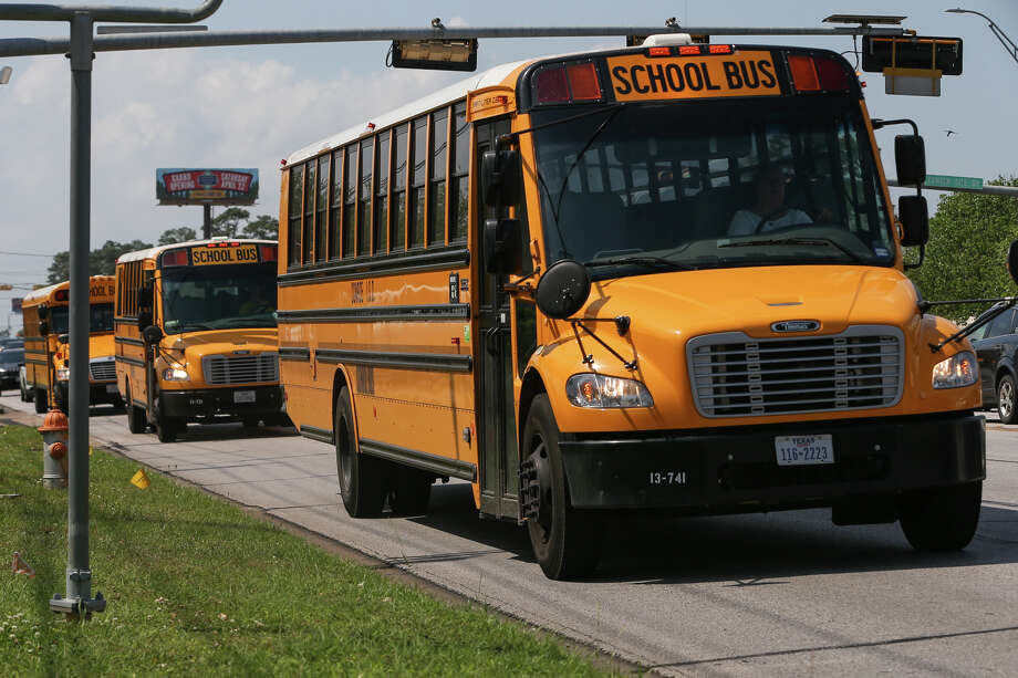 School buses from Conroe High School embark on their rounds to drop off students Tuesday, March 28, 2017, on Highway 105 in Conroe. Photo: Michael Minasi, Staff Photographer / © 2017 Houston Chronicle
