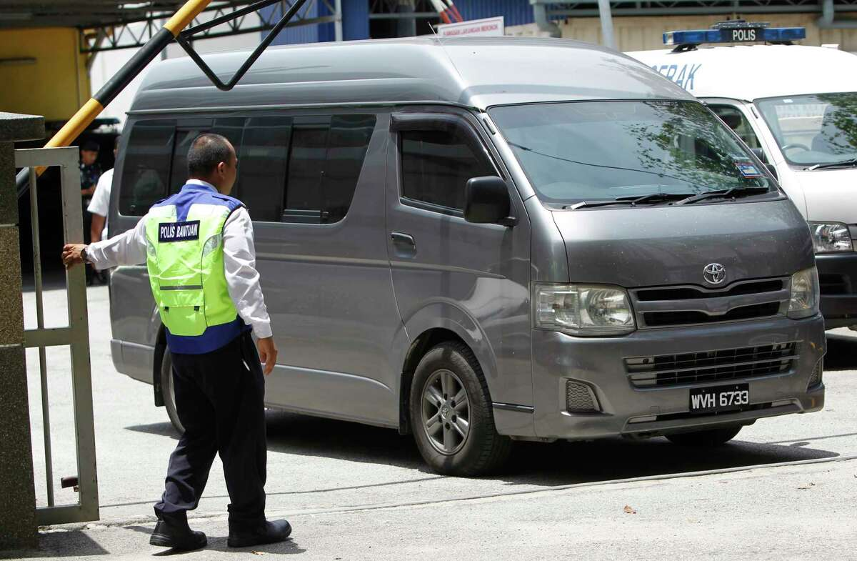 An unidentified van believed to be carrying the body of Kim Jong Nam comes out from the forensic department at Kuala Lumpur Hospital in Kuala Lumpur, Malaysia Thursday, March 30, 2017. Malaysian police on Thursday stopped guarding the morgue that held the body of North Korean leader Kim Jong UnÂ?'s murdered half-brother, after the van departed amid reports that his remains will leave the country. Shortly after the van left the hospital, police left the building and the morgue was reopened to the public.(AP Photo/Daniel Chan)