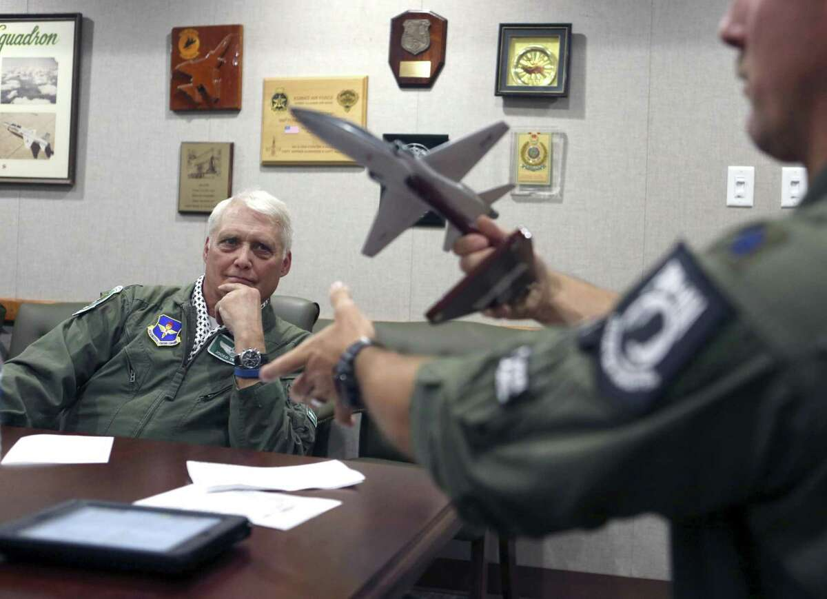 """Jack Trimble, left, receives a briefing from Lt. Col. Jon Elza as he prepares Thursday March 30, 2017 for his """"fini flight"""" with the 560th Flight Training Squadron """"Chargin' Cheetahs"""" of the 12th Flying Training Wing. Trimble was shot down while fighting in Vietnam and was never able to have his champagne flight. This was the first of just under 200 """"fini flights"""" to honor air crew shot down over North Vietnam who were not pilots."""