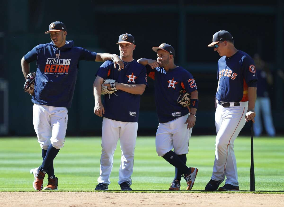 Houston Astros shortstop Carlos Correa, third baseman Alex Bregman, and second baseman Jose Altuve with manager A.J. Hinch before the start of an MLB exhibition game at Minute Maid Park, Thursday, March 30, 2017, in Houston. ( Karen Warren / Houston Chronicle )
