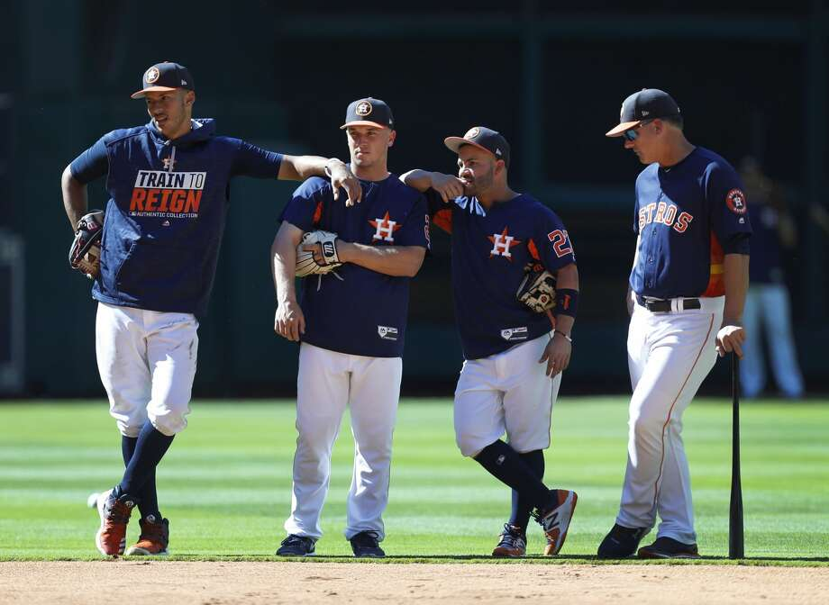 Houston Astros shortstop Carlos Correa, third baseman Alex Bregman, and second baseman Jose Altuve with manager A.J. Hinch before the start of an MLB exhibition game at Minute Maid Park, Thursday, March 30, 2017, in Houston.  ( Karen Warren / Houston Chronicle ) Photo: Karen Warren/Houston Chronicle