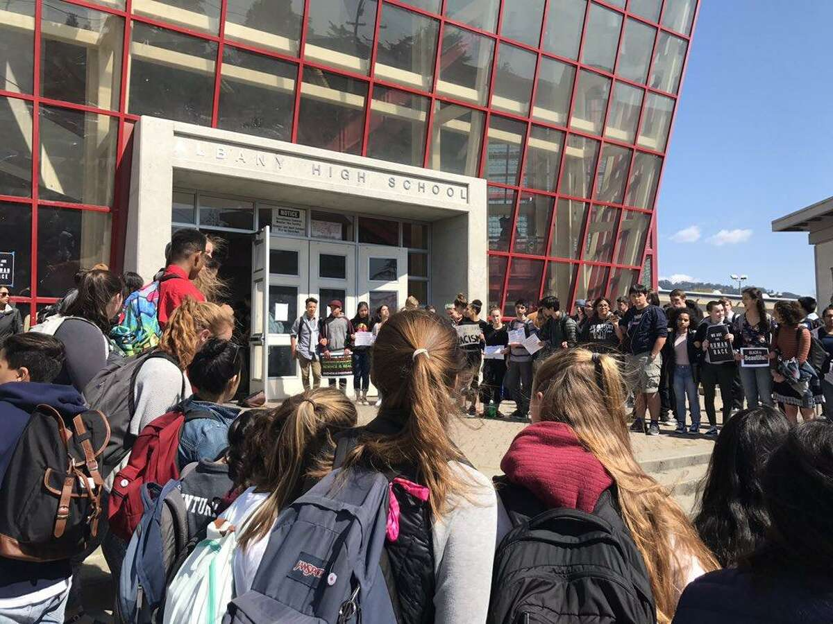 Students at Albany High School walked out of classes Thursday in protest of return to school of a group of classmates who had been suspended for allegedly posting racist attacks about fellow students on social media.