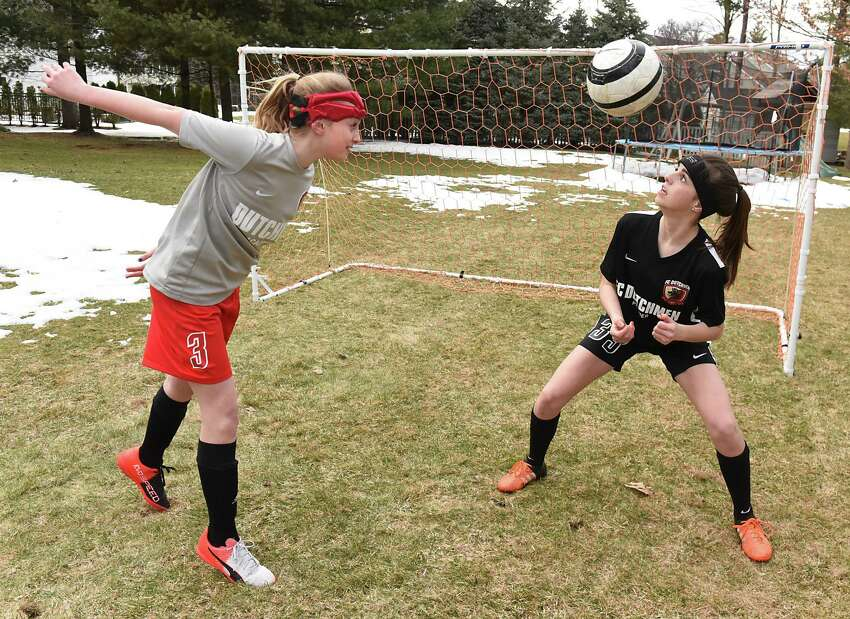 Jadyn Gavigan, 12, left, and her sister Alexandra, 16, practice soccer in their backyard on Wednesday, March 29, 2017 in Guilderland, N.Y. Both teens have had concussions, but are fine now. (Lori Van Buren / Times Union)
