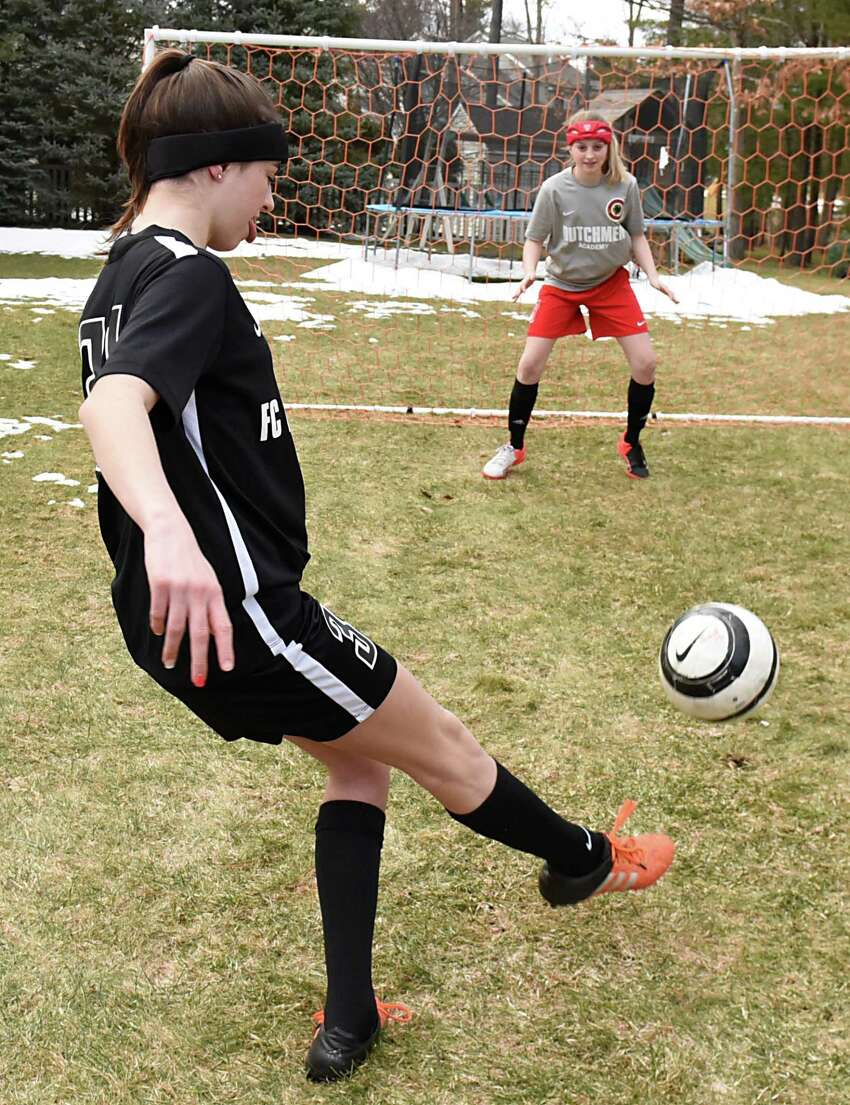 Alexandra Gavigan, 16, left, and her sister Jadyn, 12, practice soccer in their backyard on Wednesday, March 29, 2017 in Guilderland, N.Y. Both teens have had concussions, but are fine now. (Lori Van Buren / Times Union)