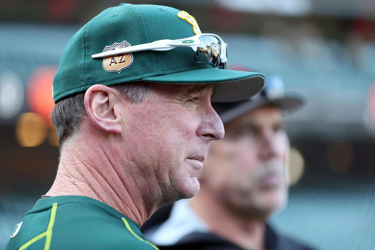 Oakland Athletics' manager Bob Melvin and San Francisco Giants' manager Bruce Bochy before Bay Bridge Series begins at AT&T Park in San Francisco, Calif., on Thursday, March 30, 2017.