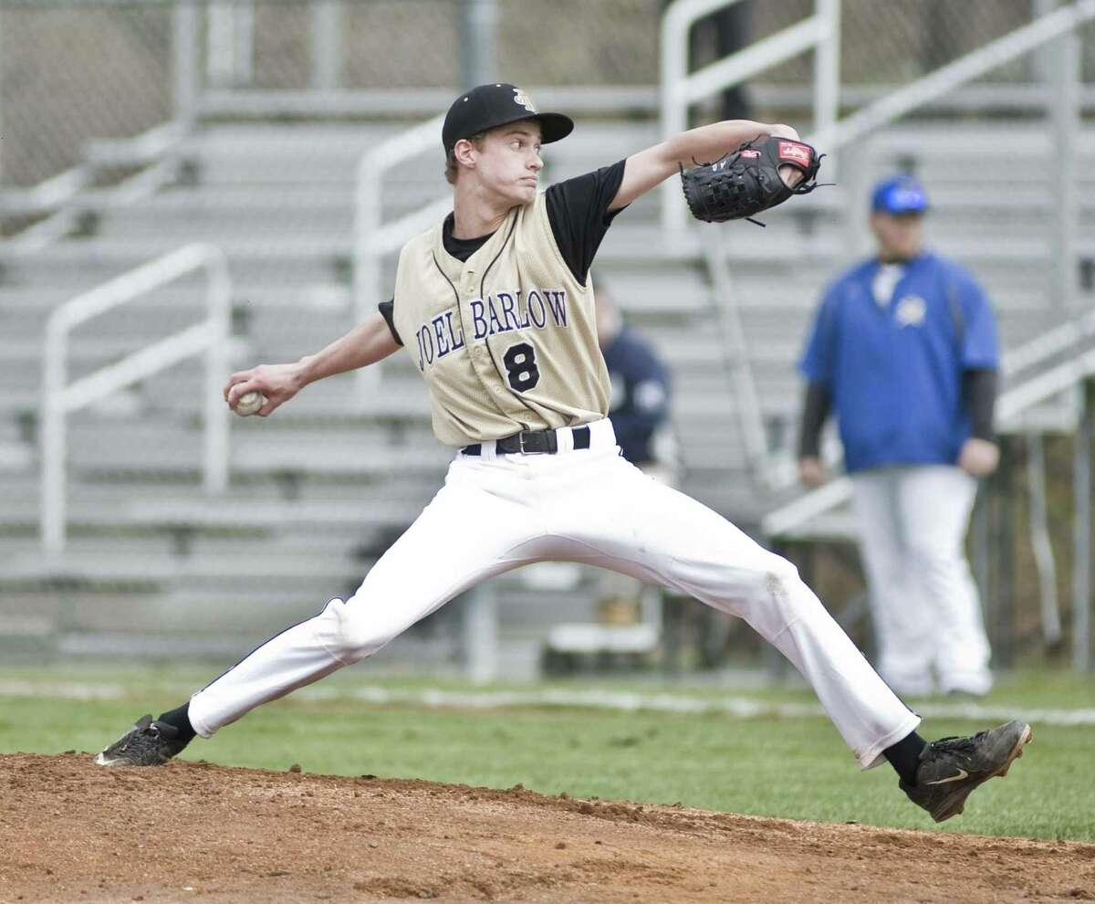 Joel Barlow High School pitcher Andrew Johnson delivering the ball in a game against Brookfield High School, played at Brookfield. Monday, April 11, 2016