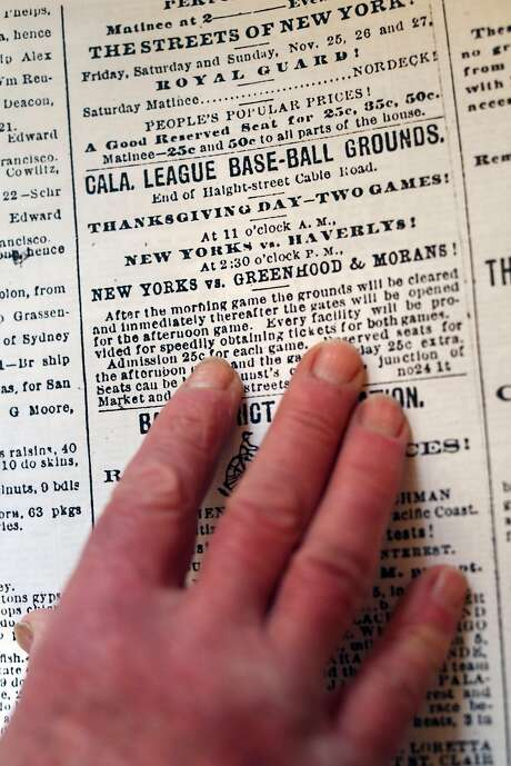 Angus Macfarlane examines a newspaper article promoting an obscure barnstorming tour by the New York Giants in 1888. Photographed at Macfarlane's home in San Francisco, Calif., on Monday, March 6, 2017. Photo: Scott Strazzante, The Chronicle
