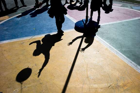 From left: Elger Pinto Guillen, 2nd grade, jumps to hit the ball as he plays with Shanti Dzib Soto, 1st grade, at the Mission Graduates Extended Day Program at Marshall Elementary on Thursday, March 23, 2017, in San Francisco, Calif. Approximately 170 students are part of the after school program there.