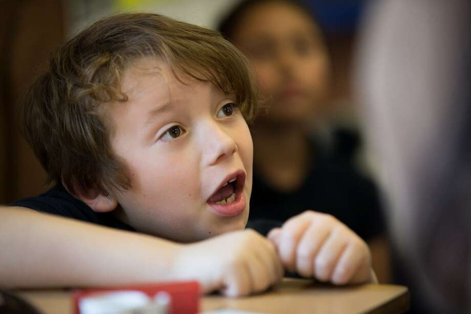 Second-grader Jude Crawford participates during community time at the Mission Graduates Extended Day Program at Marshall Elementary. Photo: Santiago Mejia, The Chronicle