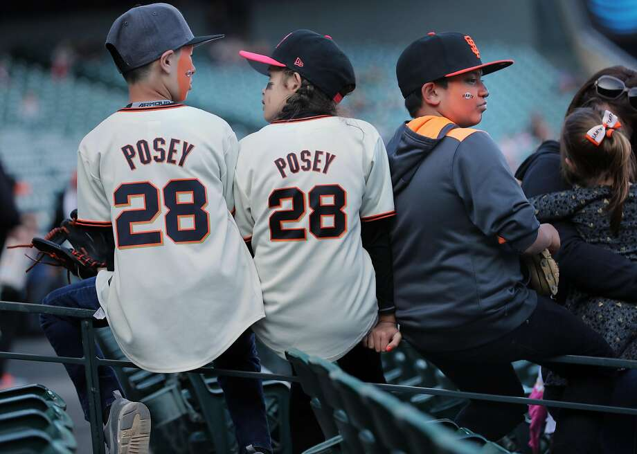 Abby Galvan, 9, Joshua Escamilla,9 and Drew Patel,13 of Fullerton, Ca. are set for the game as the San Francisco Giants prepare to take on the Oakland Athletics in pre-season action at AT&T Park in San Francisco, Ca.as seen on Thurs. Mar. 30, 2017. Photo: Michael Macor, The Chronicle