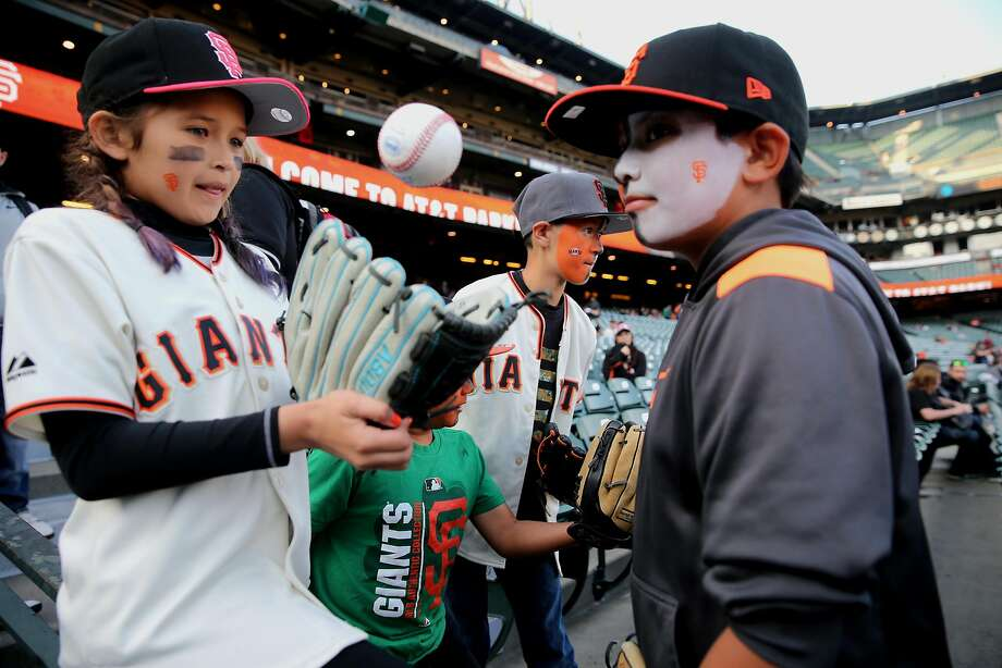 Face-painted youngsters get ready to watch the Giants host the A's in the Bay Bridge Series opener. Photo: Michael Macor, The Chronicle