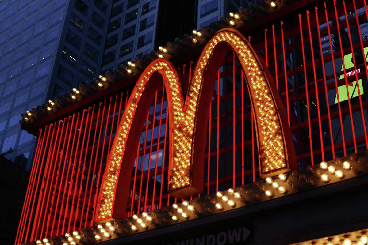 FILE - This Sunday, Jan. 10, 2016, photo shows the sign at the McDonald's restaurant on 42nd Street near Times Square in New York. McDonald's says it will swap frozen beef patties for fresh ones in its Quarter Pounder burgers by sometime in 2018 at most of its U.S. locations. Employees will cook up the never-frozen beef on a grill when ordered. (AP Photo/Gene J. Puskar, File)