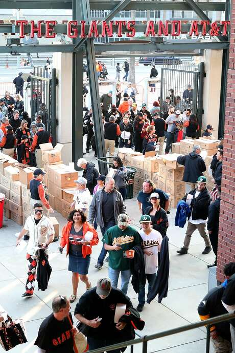 Fans of the Giants and A's arrive at AT&T Park, which opened in 2000 but remains a jewel. Photo: Scott Strazzante, The Chronicle