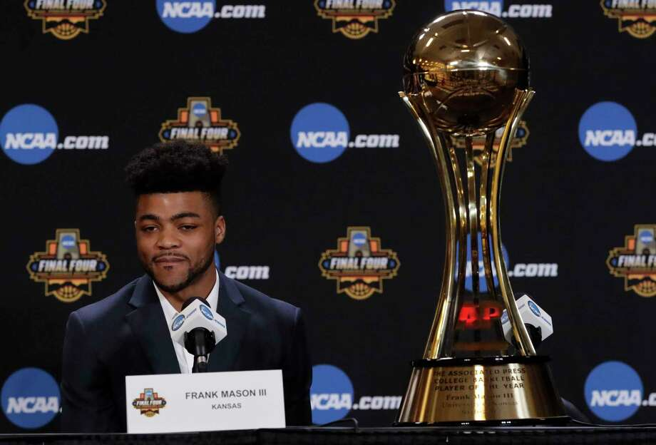 Kansas' Frank Mason III stands answers questions with his Associated Press Player of the Year trophy at a news conference Thursday, March 30, 2017, in Glendale, Ariz. (AP Photo/Matt York) Photo: Matt York, STF / Copyright 2017 The Associated Press. All rights reserved.