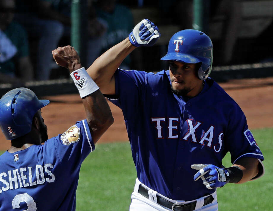 Texas Rangers' Carlos Gomez celebrates with Delino DeShields after Gomez hit a two-run home run early this spring training. during the third inning of a spring training baseball game against the Seattle Mariners, in Surprise, Ariz. Gomez would play any position for the Rangers. The outfielder just wouldn't want to play for another team right now. (AP Photo/Darron Cummings, File) Photo: Darron Cummings, STF / Copyright 2017 The Associated Press. All rights reserved.