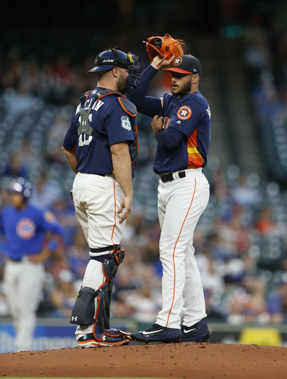 Houston Astros starting pitcher Lance McCullers Jr. (43) reacts with catcher Brian McCann (16) after giving up a run during the second inning of an MLB exhibition game at Minute Maid Park, Thursday, March 30, 2017, in Houston. ( Karen Warren / Houston Chronicle )