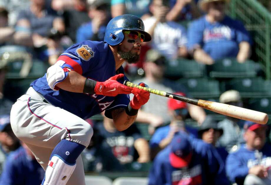 FILE - In this March 1, 2017, file photo, Texas Rangers' Rougned Odor follows through on a base hit against the Los Angeles Angels during the first inning of a spring training baseball game, in Tempe, Ariz. Odor and the Texas Rangers have agreed to a new six-year contract that includes a club option for 2023. The team announced the deal Thursday, March 30, 2017. (AP Photo/Matt York, File) Photo: Matt York, STF / Copyright 2017 The Associated Press. All rights reserved.