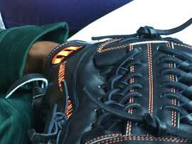 Santiago Casilla's glove. The Oakland Athletics reliever is using the black and orange Wilson A2000 he used in 2016 with the San Francisco Giants. He expects to receive a glove with green lettering soon.� March 30, 2017.
