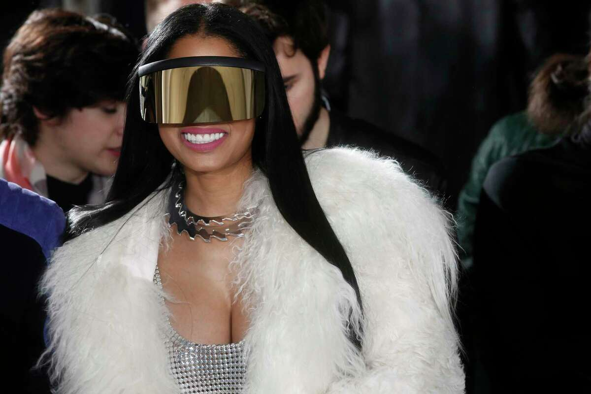 """Celebrities including Nicky Minaj, left, and Emmy Rossum are among the victims of what police suspect is """"flocking,"""" so named because gang members flock like birds to areas where home burglaries provide the biggest payoff. The Los Angeles Times reported on March 28 that $150,000 in jewelry was taken from Rossum's home in a burglary."""