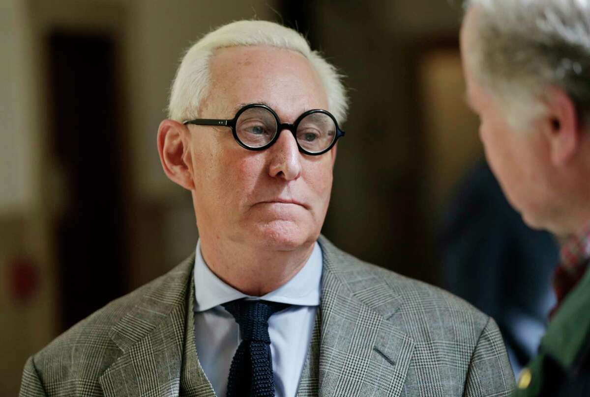 """Roger Stone talks to people outside a courtroom in New York, Thursday, March 30, 2017. Stone, a longtime political provocateur and adviser to President Donald Trump, is being sued over a flyer sent to 150,000 New York households during the state's 2010 election that called the Libertarian Party candidate for governor, Warren Redlich, a """"sexual predator."""" Stone says he had nothing to do with it. (AP Photo/Seth Wenig) ORG XMIT: NYSW104"""