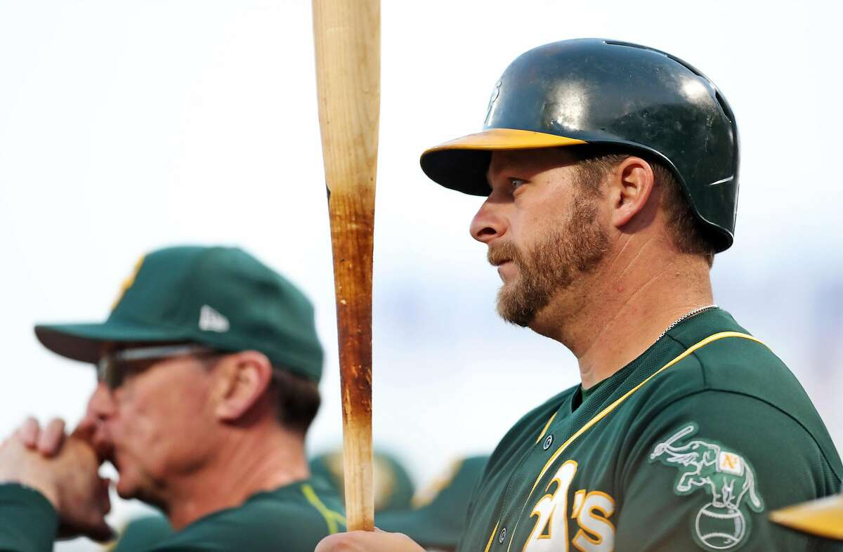 Oakland Athletics' Stephen Vogt and manager Bob Melvin against San Francisco Giants during Bay Bridge Series at AT&T Park in San Francisco, Calif., on Thursday, March 30, 2017.