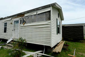 Cassandra Lilly's mobile home was damaged during heavy storms Wednesday in Newton County. The winds ripped off siding and shifted the trailer on its concrete blocks. Photo taken Thursday 3/30/17 Ryan Pelham/The Enterprise