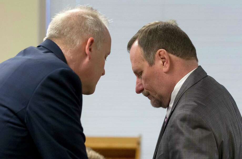 Political consultant Marc Davenport, right, is seen with his lawyer Steve Jackson before a hearing on the constitutionality of the Texas Open Meetings Act in the 221st state District Court at the Lee G. Alworth Building on Monday, March 27, 2017 in Conroe. Visiting 221st state District Court Judge Randy Clap rescheduled the hearing to Wednesday as part of the upcoming trial of two members of Montgomery County Commissioners Court and Davenport for allegedly conspiring to circumvent the act. Photo: Jason Fochtman, Staff Photographer / © 2017 Houston Chronicle