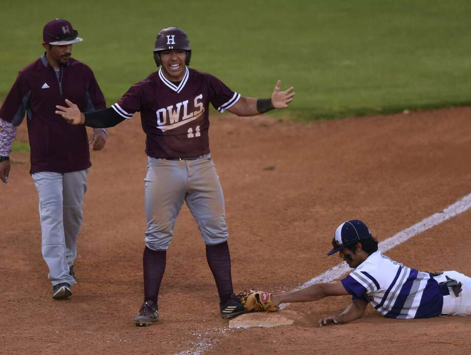 Roberto Palomino of Highlands celebrates after hitting a first-inning triple against Brackendrige during 28-5A baseball action at the SAISD baseball complex on Thursday, March 30, 20l17. Third baseman Jonathon Lucas applies a late tag. Photo: Billy Calzada / San Antonio Express-News / San Antonio Express-News