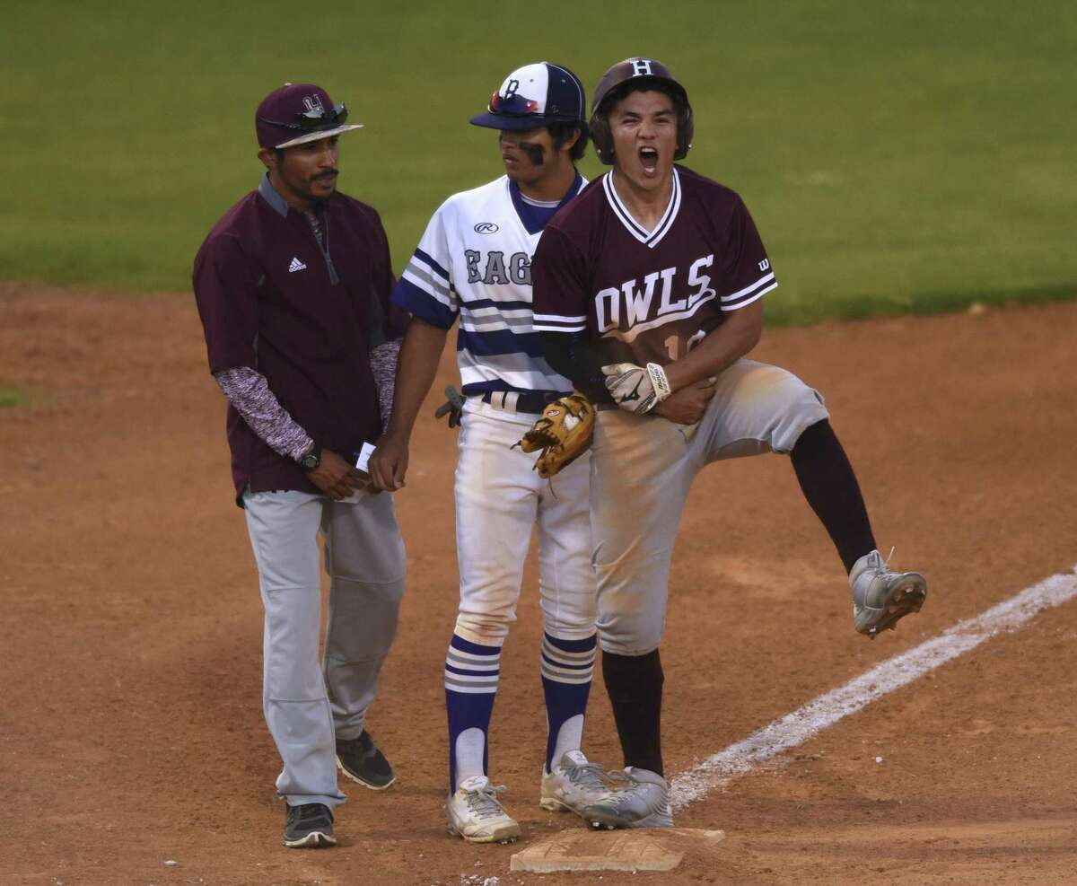 Highlands' John Cruz (right) celebrates after hitting a first-inning RBI triple against Brackenridge during a District 28-5A game at the SAISD Complex on March 30, 20l17. Brackenridge third baseman Johnathon Lucas (center) and Harlandale coach Stephen Jauregui stand by.