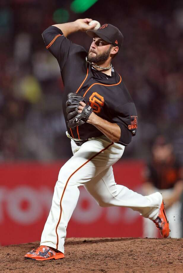 George Kontos, shown here in the March 30 Bay Bridge Series exhibition, struck out Paul Goldschmidt and Jake Lamb on Tuesday night. Photo: Scott Strazzante, The Chronicle