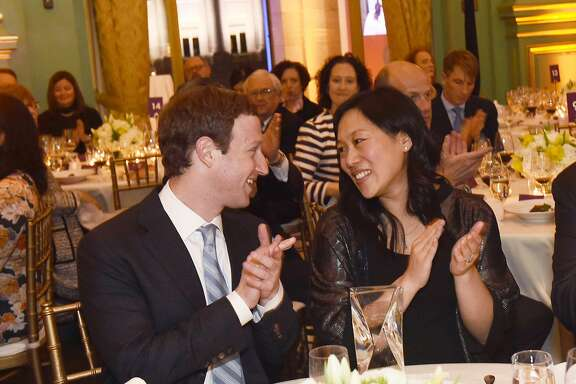 Priscilla Chan, The Chronicle�s 2017 Visionary of the Year (center) with her husband and Facebook CEO Mark CEO Mark Zuckerberg (left) at the Visionary Awards gala on Thursday, March 30, 2017, at the Opera War Memorial in San Francisco, Calif.
