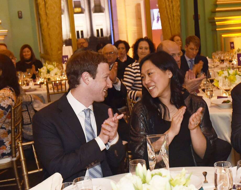 Priscilla Chan, The Chronicle's 2017 Visionary of the Year (center) with her husband and Facebook CEO Mark CEO Mark Zuckerberg (left) at the Visionary Awards gala on Thursday, March 30, 2017, at the Opera War Memorial in San Francisco, Calif. Photo: Susana Bates / Special To The Ch