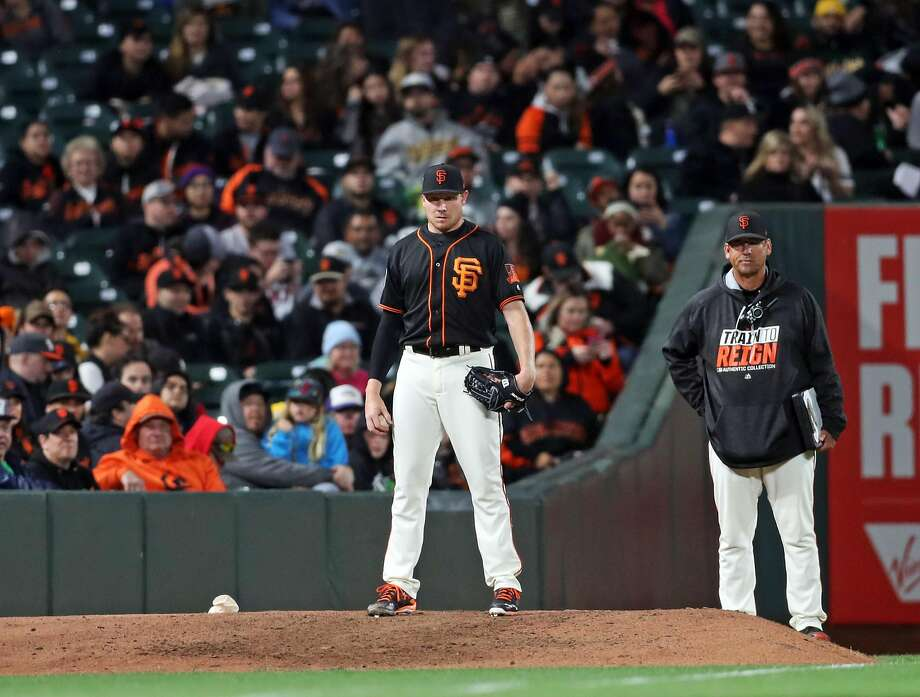 Mark Melancon stands on the bullpen awaiting the call to enter a 2017 game at AT&T Park. Photo: Scott Strazzante / The Chronicle