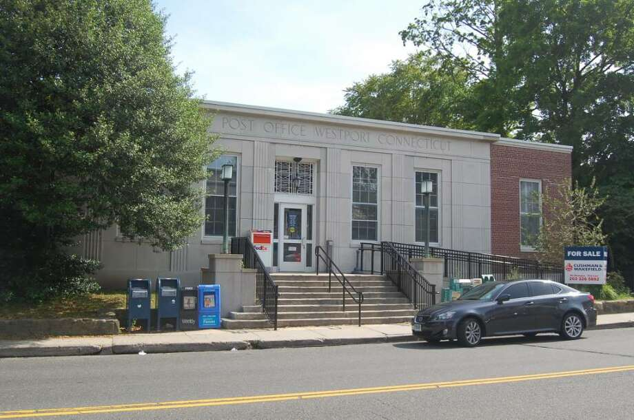 With the Main Post Office at 154 Post Road East on the market, the United States Postal Service has narrowed down possible sites to three. One of those options would be to rent out a space in the current building from whoever purchases it. Photo: Anthony Karge / Westport News