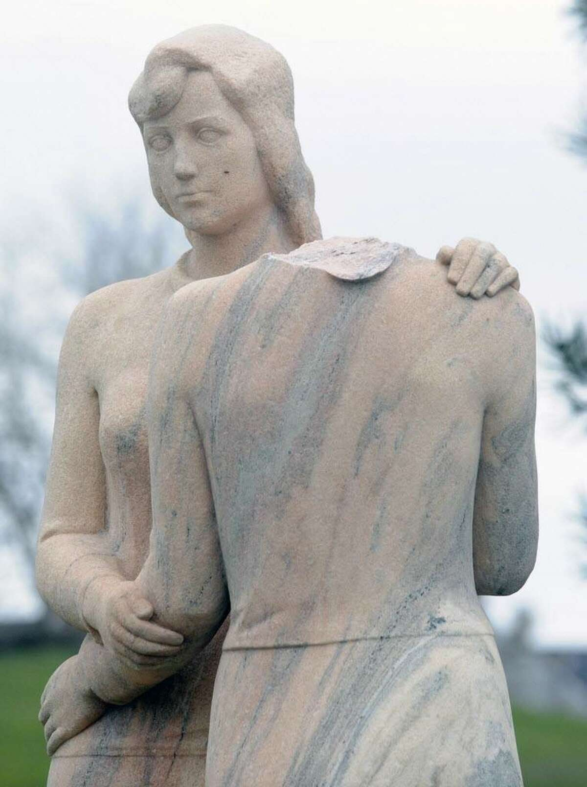 """""""Neighbors,"""" a depression era statue by Henry Kreis, stands in Czecik Marina Park on Shippan Avenue March 28, 2010. The statue, which depicts two women embracing, was damaged when the head of one of the women was cut off and taken. The head of the statue has been recovered."""