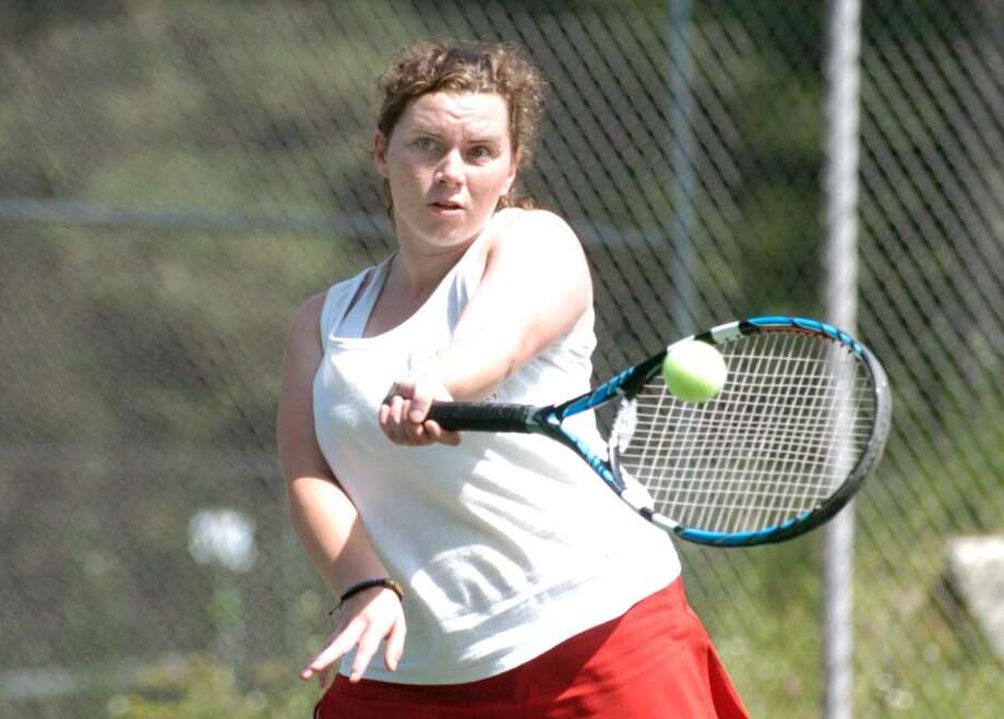 Leah Tagliarino hits during doubles match against Simsbury High School's Lauren Pollack and Julia Perrotta during state playoff match at GHS, Wednesday, June 2, 2010.  Tagliarino's partner was Jordana Cepelewicz of GHS (not in photo). Photo: Bob Luckey / Greenwich Time