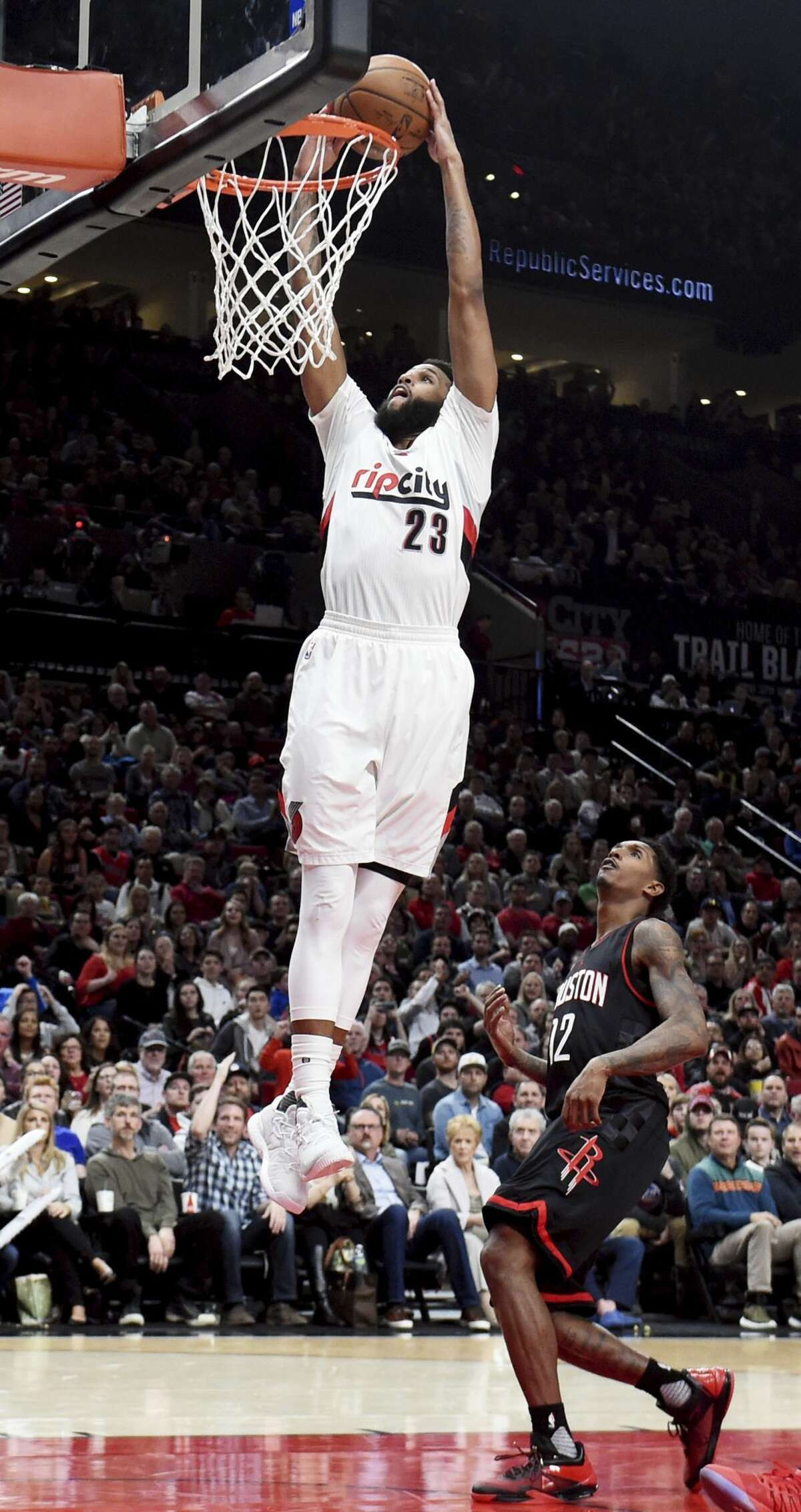 Portland Trail Blazers guard Allen Crabbe dunks the ball Houston Rockets guard Lou Williams during the fourth quarter of an NBA basketball game in Portland, Ore., Thursday, March 30, 2017. The Blazers won 117-107. (AP Photo/Steve Dykes)