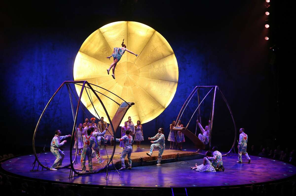 An unidentified Cirque du Soleil performer soars through the air on her way to an accidental landing at Marymoor Park in Redmond, Thursday, March 30, 2017. The woman was strapped to a backboard and removed from the stage while the show temporarily was stopped. The show announced she was