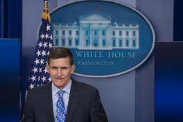 """(FILES) This file photo taken on February 1, 2017 shows  US National Security Adviser Mike Flynn speaking during the daily press briefing at the White House in Washington, DC. Flynn has """"a story to tell,"""" his lawyer said on March 30, 2017, amid reports that the ousted US national security advisor has offered to testify in exchange for immunity about potential ties between Donald Trump's presidential campaign and Russia. / AFP PHOTO / NICHOLAS KAMMNICHOLAS KAMM/AFP/Getty Images"""