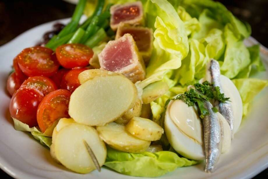 A beautiful Salade Nié§oise with the traditional trimmings – beautiful and organic lettuce, crisp green beans, fingerlings, nié§oise olives and the star — yellow fin tuna.  All tossed with a delicious Dijon vinaigrette.