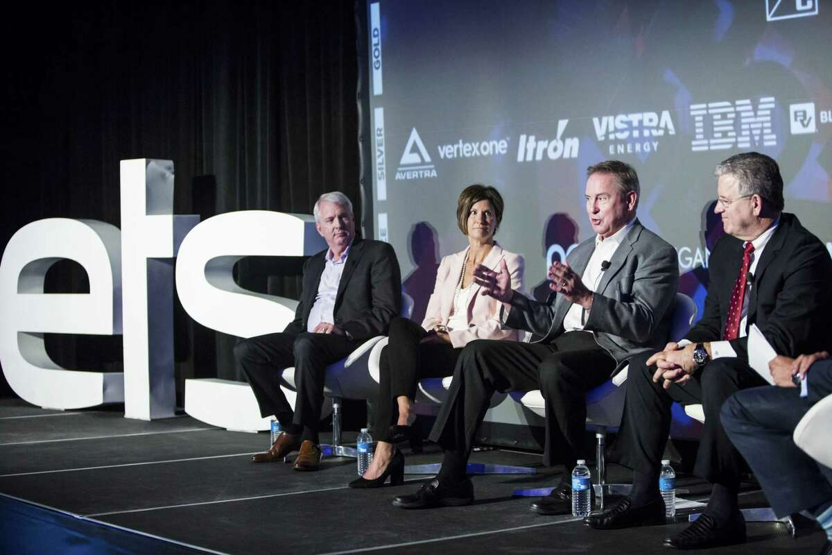 Ben Fowke, president and chief executive officer of Xcel Energy Inc., from left, Mary Powell, president and chief executive officer of Green Mountain Power Corp., Larry Weis, chief executive officer of Seattle City Light, and Rodger Smith, senior vice president and general manager of Oracle Corp., participate in a panel discussion at the ETS17 conference in Austin, Texas, U.S., on Wednesday, March 29, 2017. ETS17 calls all creative minds to convene and design real solutions for the energy transformation taking place today. Photographer: Matthew Busch/Bloomberg