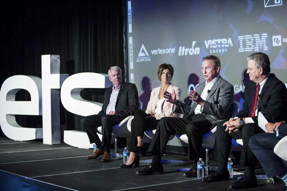 Ben Fowke, president and chief executive officer of Xcel Energy Inc., from left, Mary Powell, president and chief executive officer of Green Mountain Power Corp., Larry Weis, chief executive officer of Seattle City Light, and Rodger Smith, senior vice president and general manager of Oracle Corp., participate in a panel discussion at a 2017 conference in Austin, Texas. Xcel Energy Inc. has become the first major U.S. utility owner to pledge to fully phase out carbon-dioxide emissions that cause global warming. Photo: Matthew Busch / © 2017 Bloomberg Finance LP