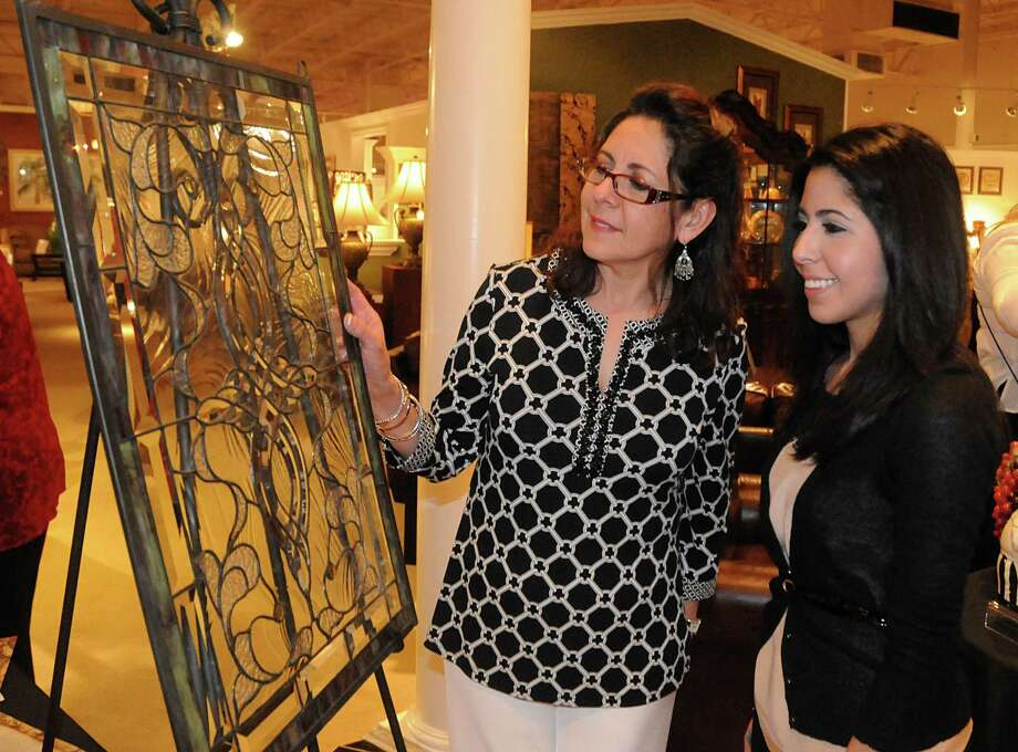 """Cathy and Sarah Silva, of The Woodlands, admire a stained glass silent auction item during the Bridgewood Farms' """"AROUND THE WORLD IN 180 MINUTES"""" wine tasting fundraiser, featuring wines from around the world, at a previous event. Participants received a """"passport"""" and received a stamp for every """"country"""" they visited. Bridgewood Farms provides programs and services for individuals with special needs. This year's event is Saturday, April 8, at Main Street America in Spring. Photo by David Hopper Photo: David Hopper, Freelance / freelance"""