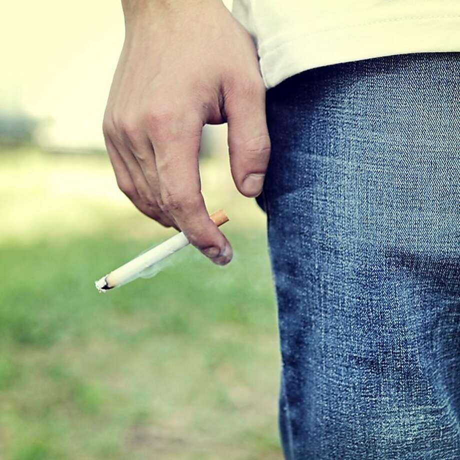 File photo of a man smoking a cigarette. Photo: Sabphoto - Fotolia