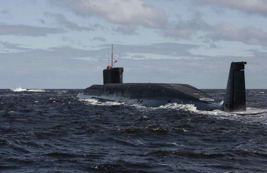 FILE - in this file photo taken on Thursday, July 2, 2009,  the Russian nuclear submarine, Yuri Dolgoruky, is seen during sea trials near Arkhangelsk, Russia.  The Russian navy said in a statement Friday March 31, 2017,  that its submarines have increased combat patrols to the level last seen during the Cold War. (AP Photo/Alexander Zemlianichenko, File) Photo: Alexander Zemlianichenko, STF / Associated Press / Copyright 2017 The Associated Press. All rights reserved.